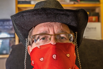Cowboy with kerchief mask and glasses.